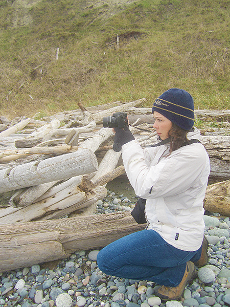 Janelle Castro focuses her frame. (photo courtesy of Land Trust staff)