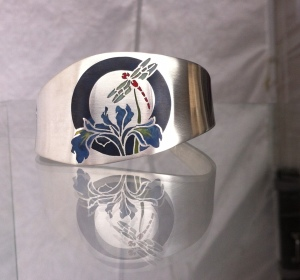 Mary Ellen O'Connor silver cuffs with colorful, hand-drawn resin inlays can be custom-made to fit any wrist.