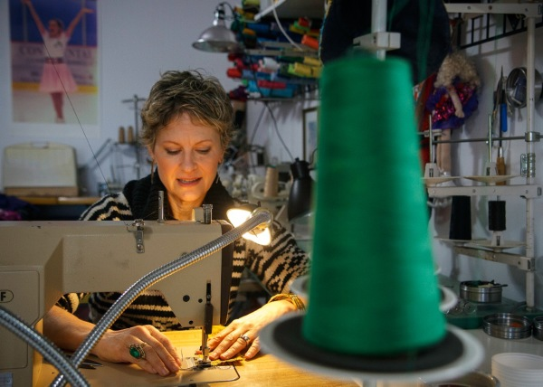Brenda at one of the nine machines in her atelier. photo by David Welton