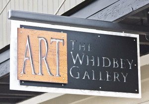 Whidbey Art Gallery sign above the door at