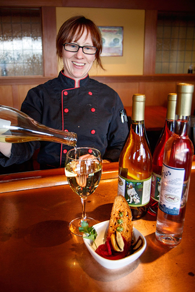 Jess Dowdell pairing Spoiled Dog Winery Sauvignon Blanc with a pickled Penn Cove mussel  (photo by David Welton)