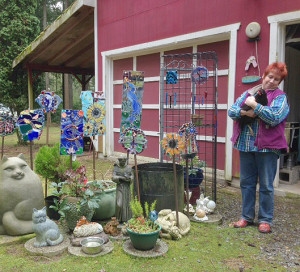 Sherren Anderson hugs one of her favorites outside her glass studio.   (photo by CJ Baker)