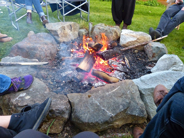 After the opening weekend readings, the playwrights and dramaturgs kick back and enjoy a fire.   /  photo by Julie O'Brien)