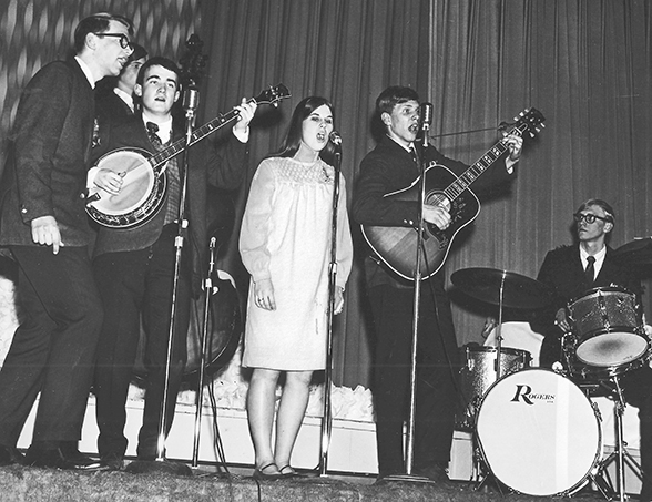 """The Northstar Singers were the """"big name band"""" imported from Minneapolis to sing at Waldorf College, Forest City, Iowa in spring 1967. Band members, left to right: Dan Nelson (lead vocals), Rod Grimm Lewis (background, on bass), Tom Pederson (banjo), Patty Elias (vocals), Al Benson (guitar) and Steve Gjertson (percussion).  (photo courtesy of Al Benson)"""