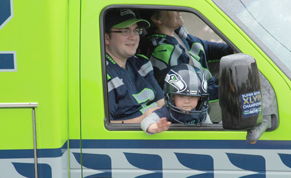 Seattle Seahawks emergency vehicle with young crew member  (photo by Martha McCartney)