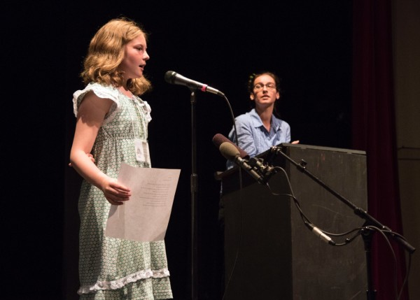 "Aurora Moore reads ""Tulips"" with coach Kathryn Morgen looking on"