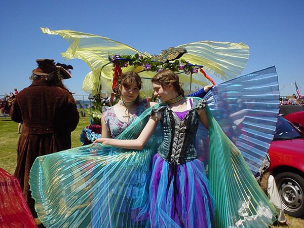 Colorful costumes abound, such as shimmering butterflies