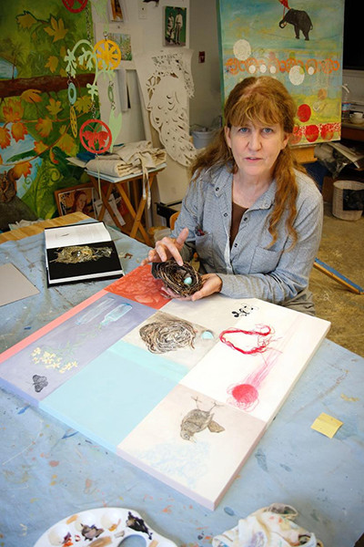 Koch showing the bird's nest used in one of her paintings. (photo by David Welton)