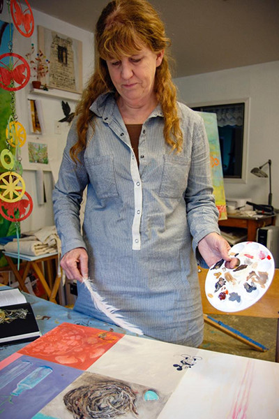 Koch with her palette and objects of inspiration. (photo by David Welton)