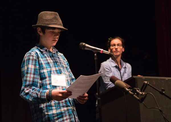 "Tyler King reads ""The Runners"" during the rehearsal session."