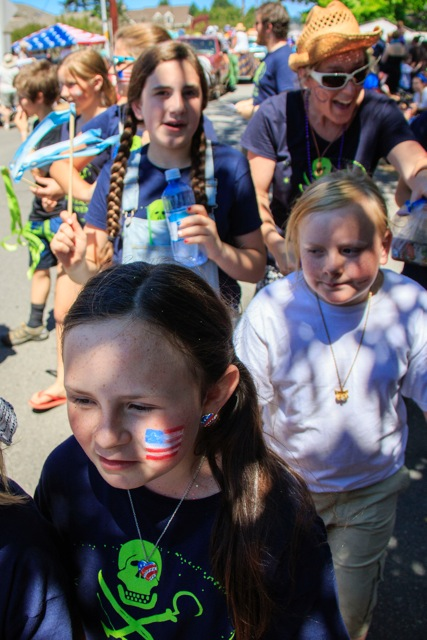 Consider camouflaging yourself with patriotic hair coloring and face painting