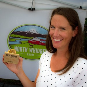 "A vender at North Whidbey Soap's booth shows off their ""Lemon and Honey"" bar   (photo by David Welton)"