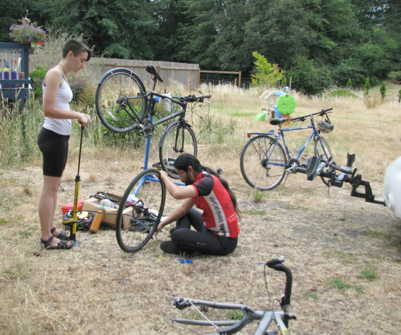 Erika Lundahl and Derek Hoshiko fills bike tires in preparation for the 68-mile training ride.   (photo by Ann Linnea)