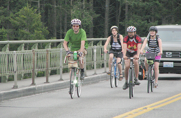 The Tar Sands riders on the Deception Pass bridge, (and photo at top) L-R: Phil Jones (green), Erika Lundahl, Derek Hoshiko and Heather Elder, graphic artist for the project   (photo by Ann Linnea)