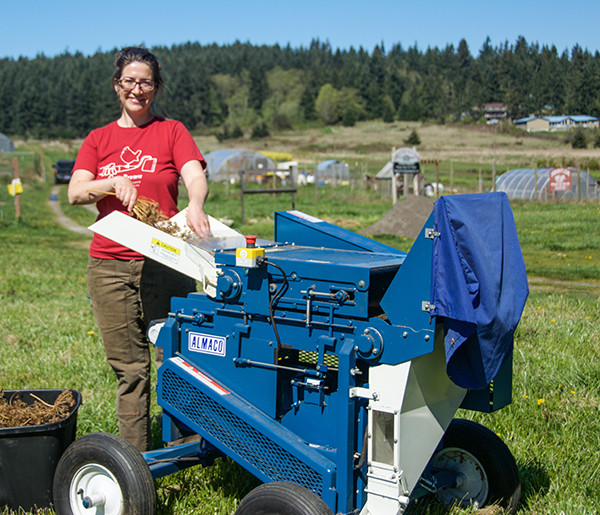 Jessica Babcock uses equipment from the Organic Seed Program to clean Bouquet Dill seeds, grown in the Greenbank Farm field and acclimated to the Pacific Northwest.   (photo by Marsha Morgan)