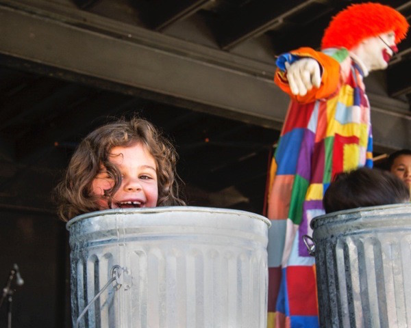 Deano the Clown manages to get kids into trash bins—and they seemed to actually enjoy it.   (photo by Emily Alexander)