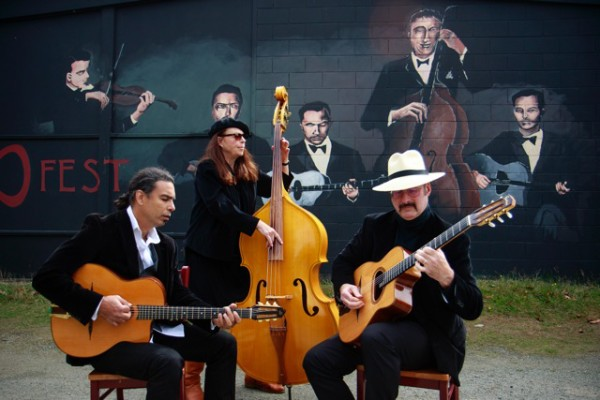 Hot Club of Troy in front of the DJangoFest mural at WICA (photo by David Welton)