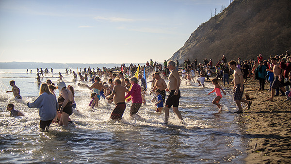 "Hundreds brave the icy water at Double Bluff beach on New Year's Day. See the article ""A Winter Weekend On Whidbey"" (photo by David Welton)"