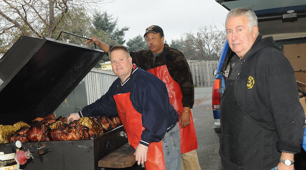Roger Anglum and his crew tend to the smoked hams and turkeys. (photo courtesy of North Whidbey Community Harvest)