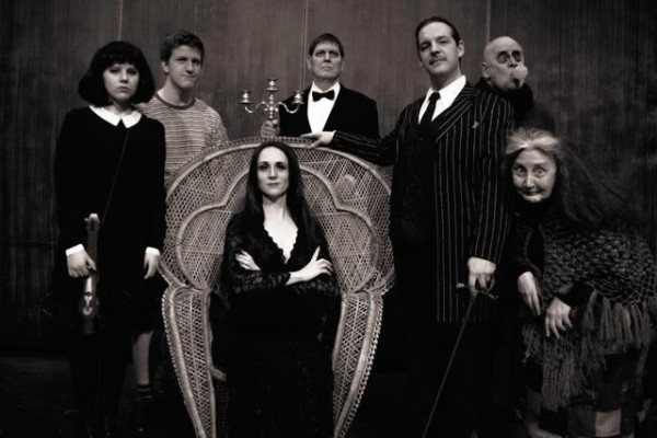 "Whidbey's ""Addams Family"" — From left to right: Erica Major (Wednesday), Austin Morehouse (Pugsley), Jennifer Bondelid (Morticia), Kevin Lynch (Lurch), Jim Castaneda (Gomez), Kent Junge (Fester) and Melanie Bacon (Grandma) recreate the iconic Addams Family portrait. (photo by David Welton)"