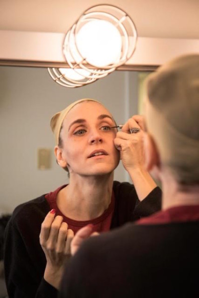 Jennifer Bondelid (Morticia) gets ready in the dressing room. (photo by David Welton)