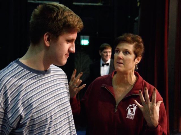 Lani Brockman directs Austin Morehouse (Pugsley) in a scene while Kevin Lynch (Lurch) looks on. (photo by David Welton)