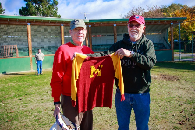 Rich and Lanny Workman show off the treasured uniform. (photo by David Welton)