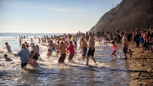 More than a hundred people make the plunge at Double Bluff Beach. (photo by David Welton)