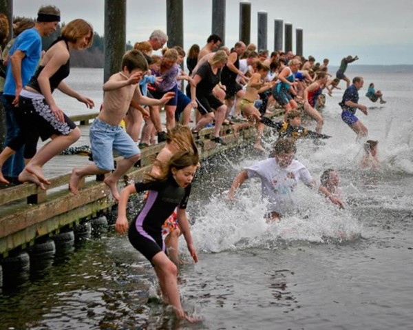 Kids of all ages participate in the Polar Bear Plunge, here at Freeland Park. (photos by David Welton)