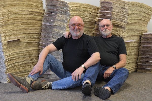 The Richards relax after hand-finishing thousands of sheets of wall covering for Four Seasons Hotel last winter. / Photo by Cannon/Bullock