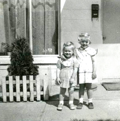 Conard with her younger sister, Maureen, outside their Coupeville home, 1955 (photo furnished by Nancy Conard)
