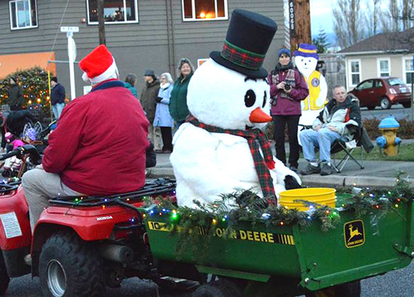 "Conard, dressed as Frosty The Snowman, in the annual ""Greening of Coupeville Parade."" (photo furnished by Nancy Conard)"