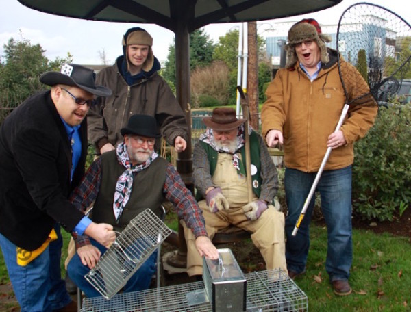 The 49ers, who want to humanely trap and deliver the bunnies to Sir Laurence Burton's haven, with cohorts Elmer Dud and Wiley Bunie. L to R: Joe Curr (Bob Essex), Daryl B. Morticome (Dave Holt), Wiley Bunie (Sean McDougald), C.Z. Cash (Fred O'Neil), and Elmer Dud (Joe McDougald). (photo by Sharon Lundahl)