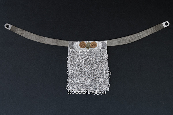Olsen used up some of her stash creating a few loincloths. This one incorporates soda tabs and wine foils. Another is made from used teabags and a flattened wire coil, decorated with capacitors. (photo by Earl Olsen)