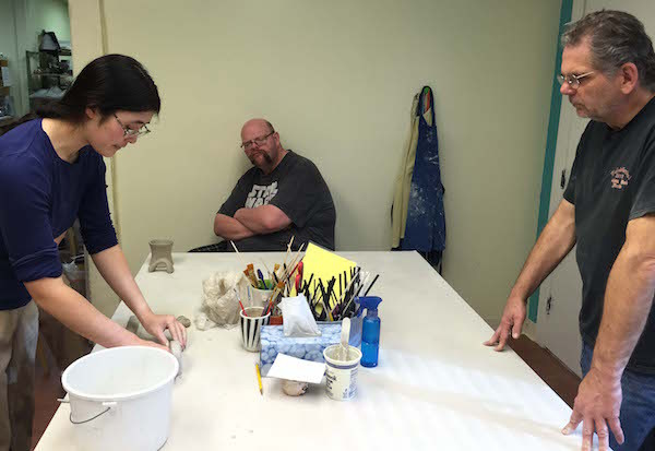 Gordon Stewart and John Heard listen to Instructor Clovy Tsuchiya of Clovy Tsuchiya Pottery (photo by Vicky Brown)