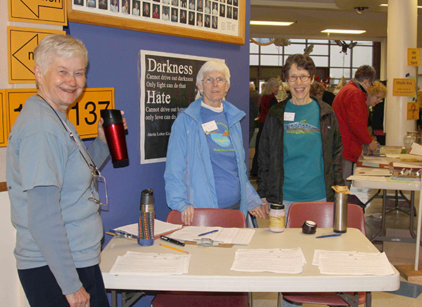 Volunteers Connie Clark, Penny Harger and Cheryl Lowe, at last year's Sound Waters, are prepared to welcome and register walk-in attendees. (photo by Jill Hein)