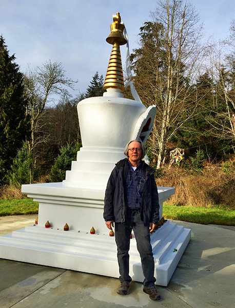 Chuck Pettis of Earth Sanctuary, stands by a Tibetan stupa. (photo by Kate Poss)