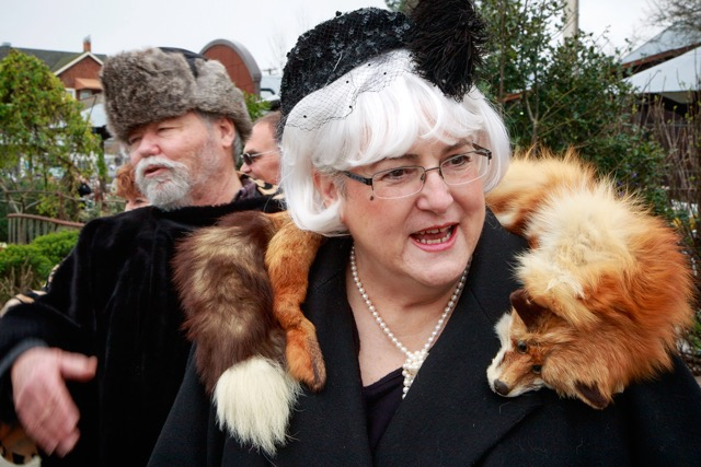 Rolf Skinner, left, is part of the Hasenpfeffer Incorporated group that wants to make rabbit stew, while Shakespeare festival patron Portia Romero wears her own furry friend.
