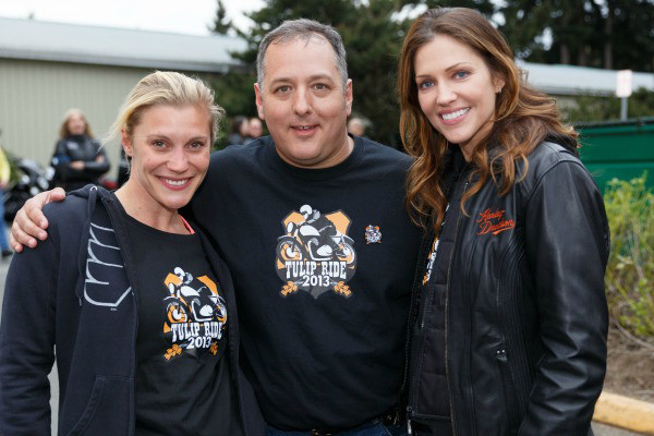Tulip Ride founder Jeff Henshaw poses with actresses Katee Sackhoff (left) and Tricia Helfer (right). (photo by Christopher Evans)