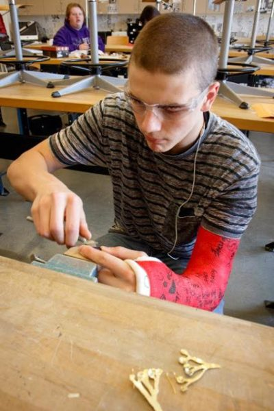 Freshman Cody Fenton came in early everyday to Oak Harbor High School to work on his Joshua tree earrings. (Photo by David Welton)