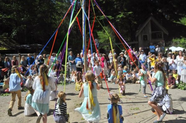 Waldorf students begin dance to weave Maypole ribbons (photo courtesy of Whidbey Island Waldorf School)