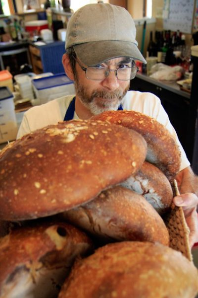 Breadmaker, Michael Tu, cools down his creations. (photo by David Welton)
