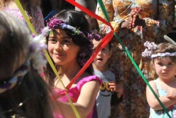In the flow of Maypole ribbons (photo courtesy of Whidbey Island Waldorf School)