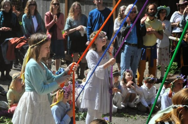 Waldorf Students practice to get the Maypole dance just right (photo courtesy of Whidbey Island Waldorf School)