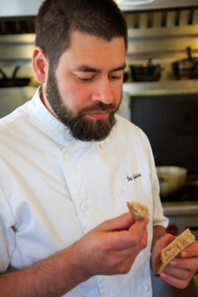 Hansen likes to experiment with textures and flavors. Here, he tastes a new bread recipe. (photo by David Welton)