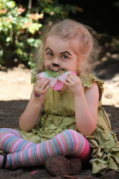 A little girl enjoying a snack at MayFaire (photo courtesy of Whidbey Island Waldorf School)