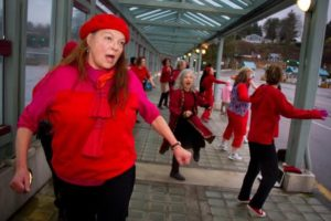 And yet another—the red beret. O'Donnell as community activist, participating in a flash dance at the ferry dock a few years ago (photo by Dave Welton)