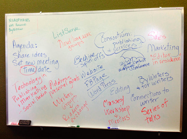 By the first meeting's end, the whiteboard was filled with ideas and dreams. (photo by Margaret Bendet)
