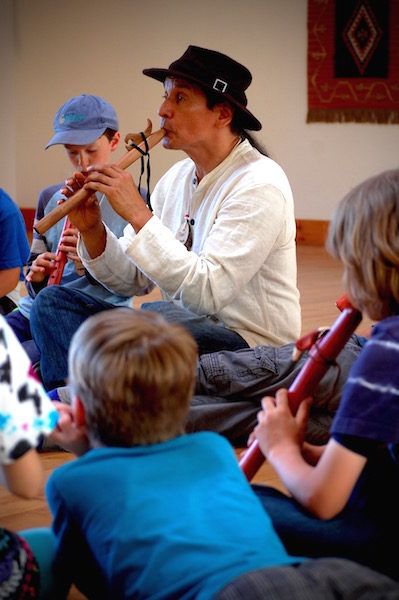 "Paul ""Che oke ten"" Wagner, an award-winning Native American flutist, shares his music with Waldorf students. (photo by Norma Fickel)"