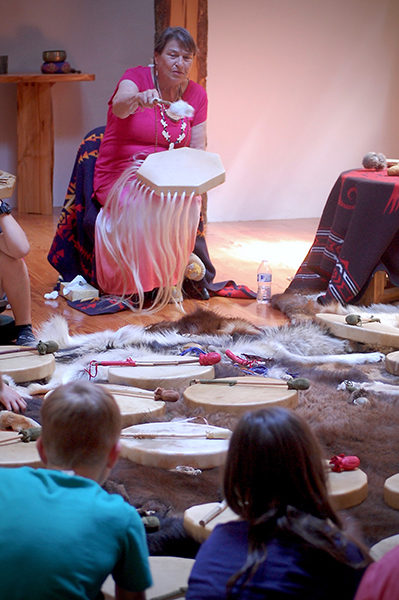 "Bonnie Pemberton, ""Soaring Eagle Woman,"" teaches students to make drums. (photo by Norma Fickel)"
